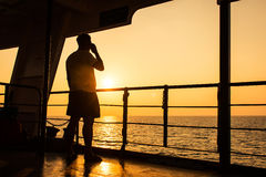 Young man use smart phone on the ship Stock Photo
