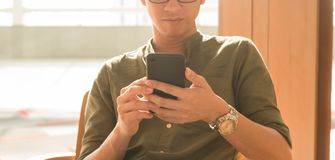 Young man use smartphone in afternoon, technology lifestyle of n. Ew generation of nomad workers stock image