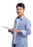 Young man use of tablet pc Stock Images