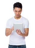 Young man use of the tablet pc Stock Photography
