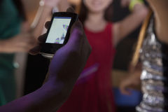 A young man uses a mobile phone in nightclub Stock Image