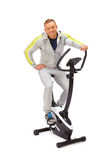 Young man uses stationary bicycle trainer. Stock Images