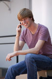 Young Man Using a Cell Phone Stock Photo