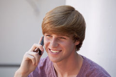 Young Man Using a Cell Phone Royalty Free Stock Image