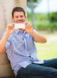 Young man using cell phone Stock Photos