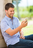 Young man using cell phone Royalty Free Stock Images