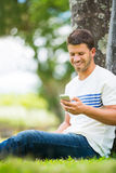 Young man using cell phone Royalty Free Stock Photography