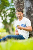 Young man using cell phone Stock Image