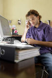 Young man Using Cellphone In Office Stock Photo