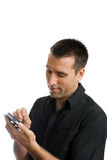 Young man using cellphone, smiling Stock Image