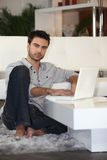 Young man using computer Royalty Free Stock Photo