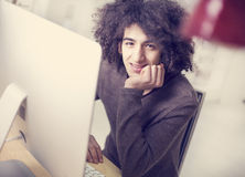 Young man using computer Stock Photography