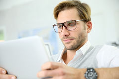 Young man using digital tablet Stock Photography