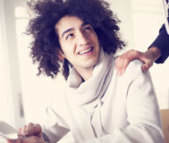 Young man using digital tablet and shows his friend Royalty Free Stock Images