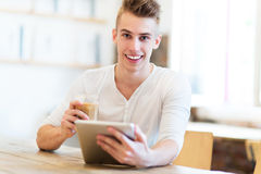 Young man using digital tablet Royalty Free Stock Images