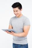 Young man using digital tablet Royalty Free Stock Photos
