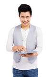 Young man using digital tablet Royalty Free Stock Image