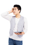Young man using digital tablet Stock Photo