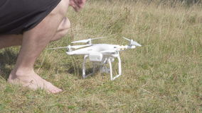 Young man using drone in the mountains stock video footage