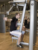 Young man using an exercise machine Royalty Free Stock Photo