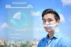 Young man using face recognition Stock Images