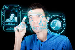 Young Man Using Futuristic Virtual Interface Royalty Free Stock Images