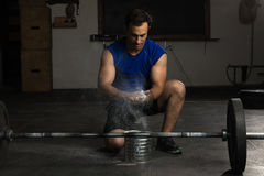 Young man using gym chalk Royalty Free Stock Image