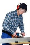 Young man using hacksaw Royalty Free Stock Photos