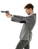 Young man using handgun Stock Images