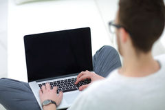 Young man using his laptop, close up Stock Photo