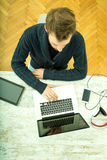 Young man using his laptop computer at home Stock Photo