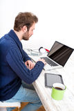 Young man using his laptop computer at home Stock Image
