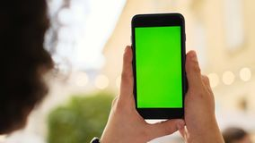 young man using his mobile phone in city. Close up of a man using mobile smart phone stock image