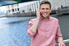 Young man using his mobile phone at outdoors Royalty Free Stock Photography