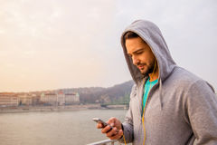 Young man using his phone Royalty Free Stock Photos