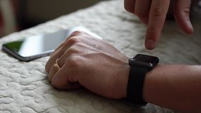 Young man using his smart watch app close up hands. 4K stock footage