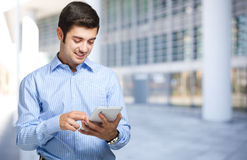 Young man using his tablet Royalty Free Stock Image