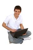 Young man using lap-top. Young man,in casual clothes,using his lap-top.Isolated on white Royalty Free Stock Photo
