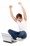Young man using laptop. Young man sitting on floor with laptop Royalty Free Stock Images