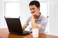 Young man using the laptop Stock Images