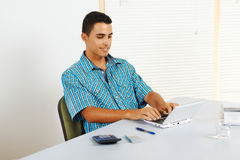 Young man using a laptop Stock Images