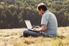 Young man using laptop Stock Photo