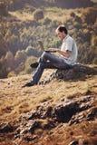 Young man using laptop Royalty Free Stock Photos