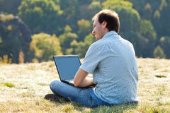 Young man using laptop Royalty Free Stock Photo