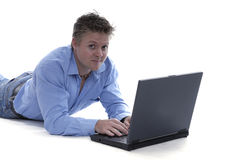 Young man using a laptop Stock Image