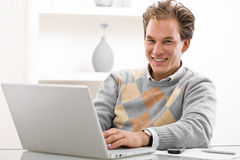 Young man using laptop Stock Photos
