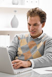 Young man using laptop stock photography