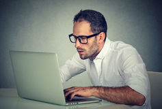 Young man using a laptop Royalty Free Stock Photography