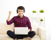 young man using laptop computer with headset Stock Image
