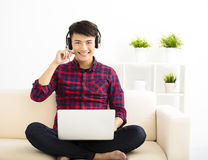 young man using laptop computer with headset Royalty Free Stock Photo